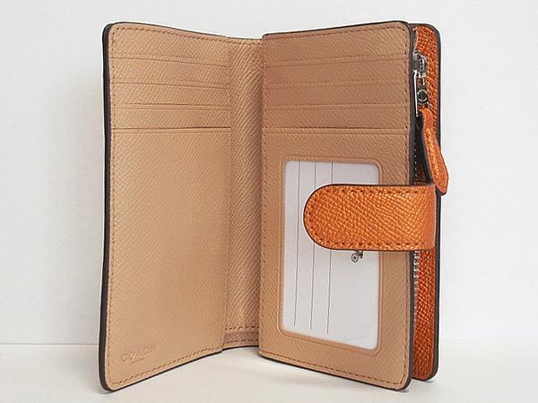 コーチ 二つ折り財布F23256オレンジ カード入れ