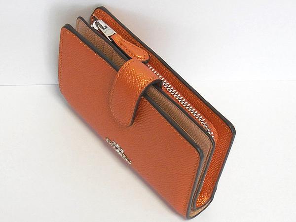 コーチ 二つ折り財布F23256オレンジ 天面