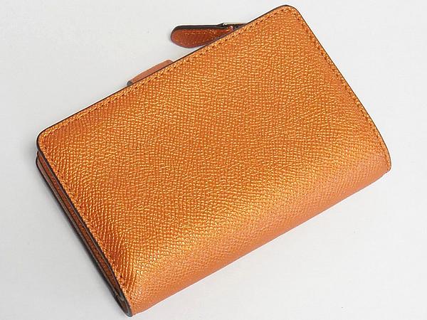 コーチ 二つ折り財布F23256オレンジ 背面
