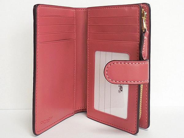 コーチ 二つ折り財布F73374花柄ピンク カード入れ
