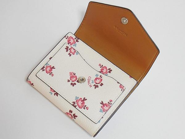 コーチ 三つ折り財布27112花柄白 前ポケット