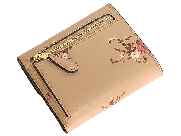 コーチ 三つ折り財布66569花柄ベージュ 背面