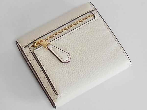 コーチ 三つ折り財布F73381花柄白 背面